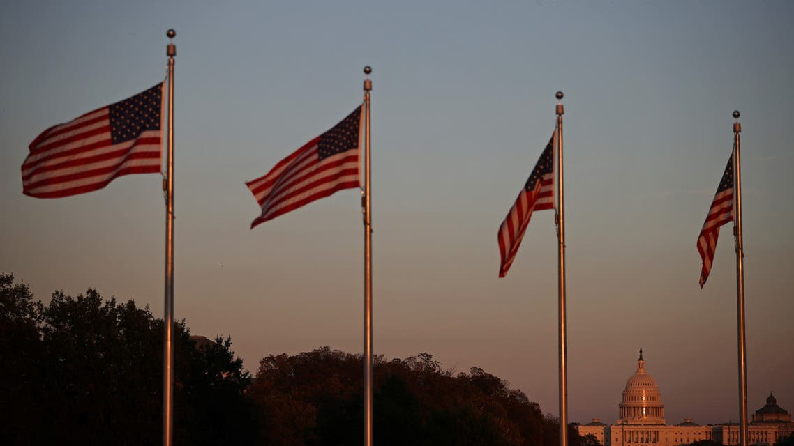 The United States Capitol is pictured among U.S. flags during sunset in Washington. (Reuters)
