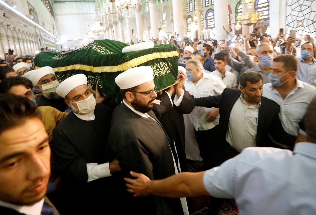 Mourners hold the coffin of Sunni Muslim Mufti Sheikh Mohammed Adnan Afiouni, during his funeral at Umayyad mosque in Damascus. (Reuters)