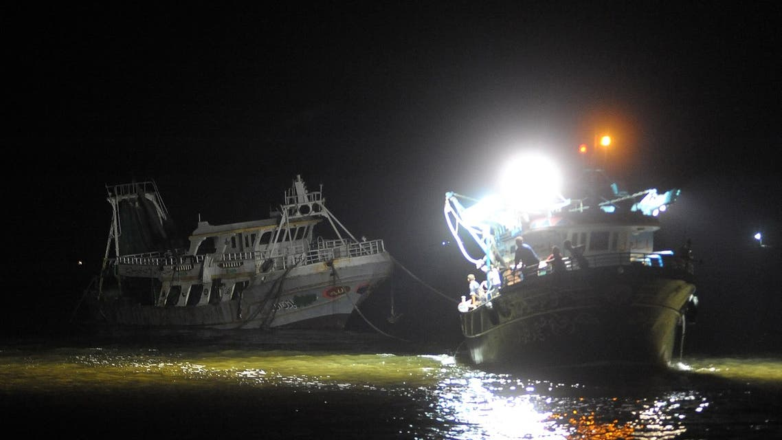 A picture taken in the Egyptian port city of Rosetta on September 27, 2016 shows the arrival of wreck of a migrant boat raised by the Egyptian navy and maritime rescuers. (AFP)
