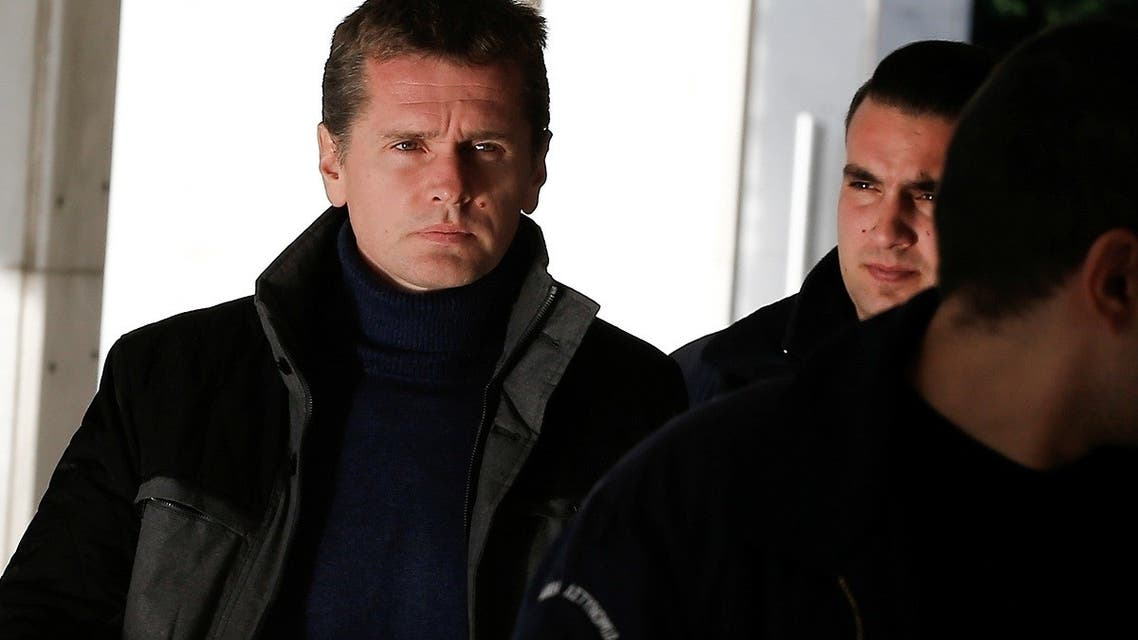 Alexander Vinnik, a 38 year old Russian man suspected of running a money laundering operation using bitcoin, is escorted by police officers to a court in Athens, Greece. (Reuters)