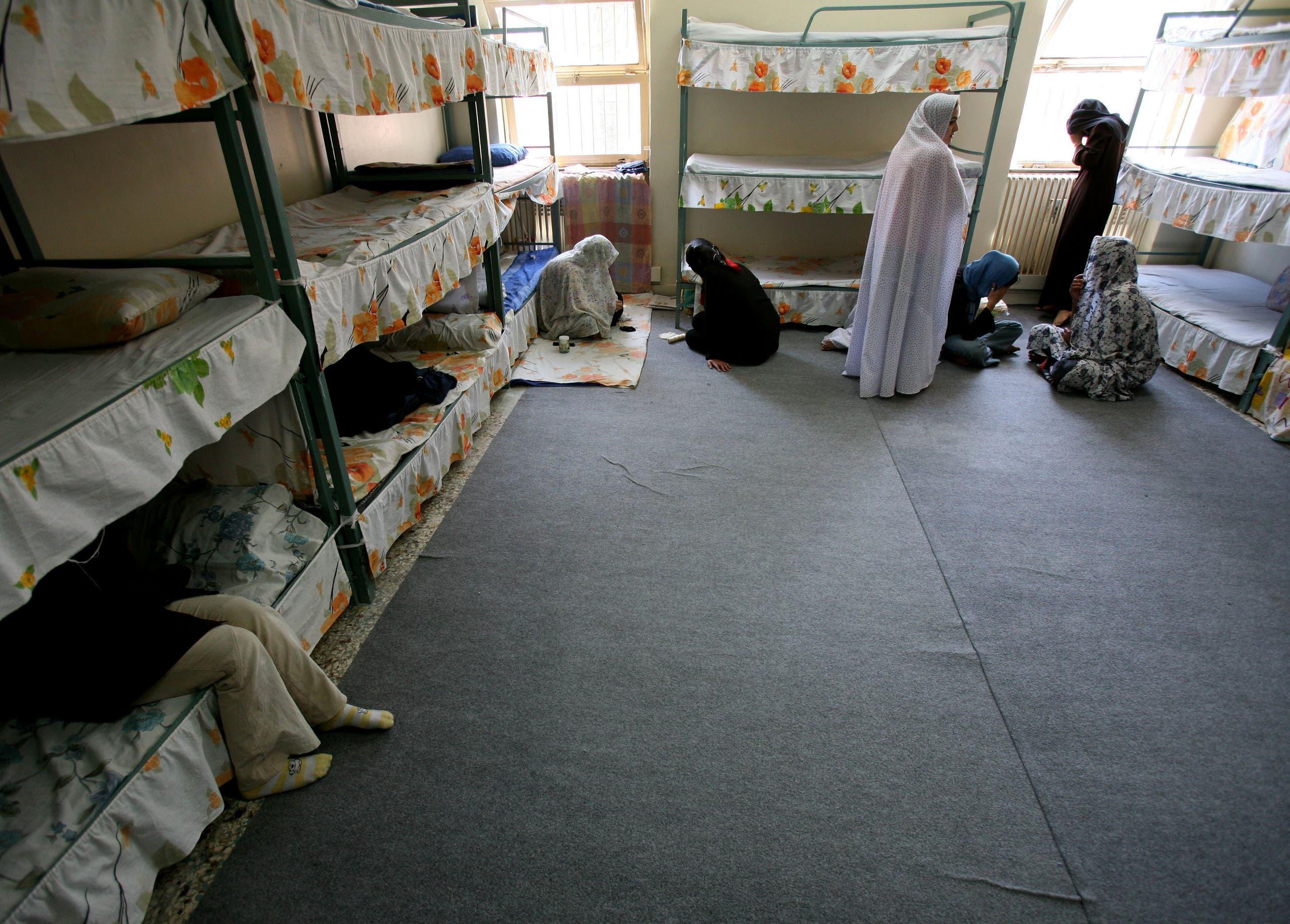 Iranian women prisoners sit inside a cell in Tehran's Evin prison. (Reuters)