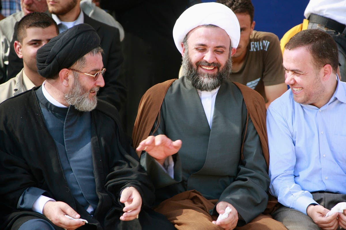 Hezbollah senior officials Ibrahim al-Amin (L), Nabil Qaouk (C) and Hassan Fadlallah laugh during celebrations after receiving the remains of Hezbollah and Palestinian fighters. July 16, 2008. (AP)