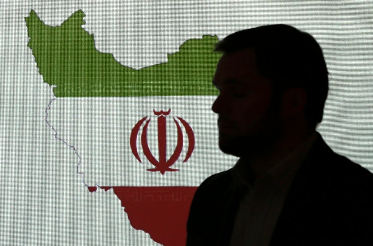Stuart Davis, a director at one of FireEye's subsidiaries, stands in front of a map of Iran as he speaks to journalists about the techniques of Iranian hacking, Sept. 20, 2017, in Dubai. (AP)