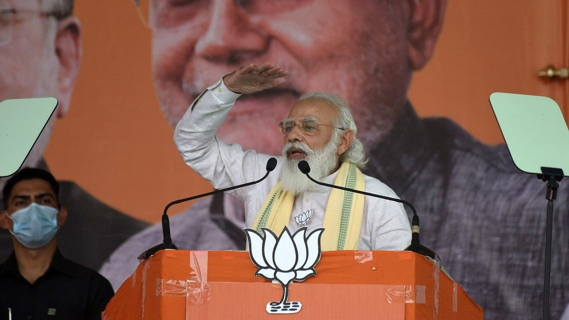 India's Prime Minister Narendra Modi gestures as he addresses his supporters during an election campaign meeting ahead of state assembly election in Dehri, eastern state of Bihar, India, on October 23, 2020. (Reuters)