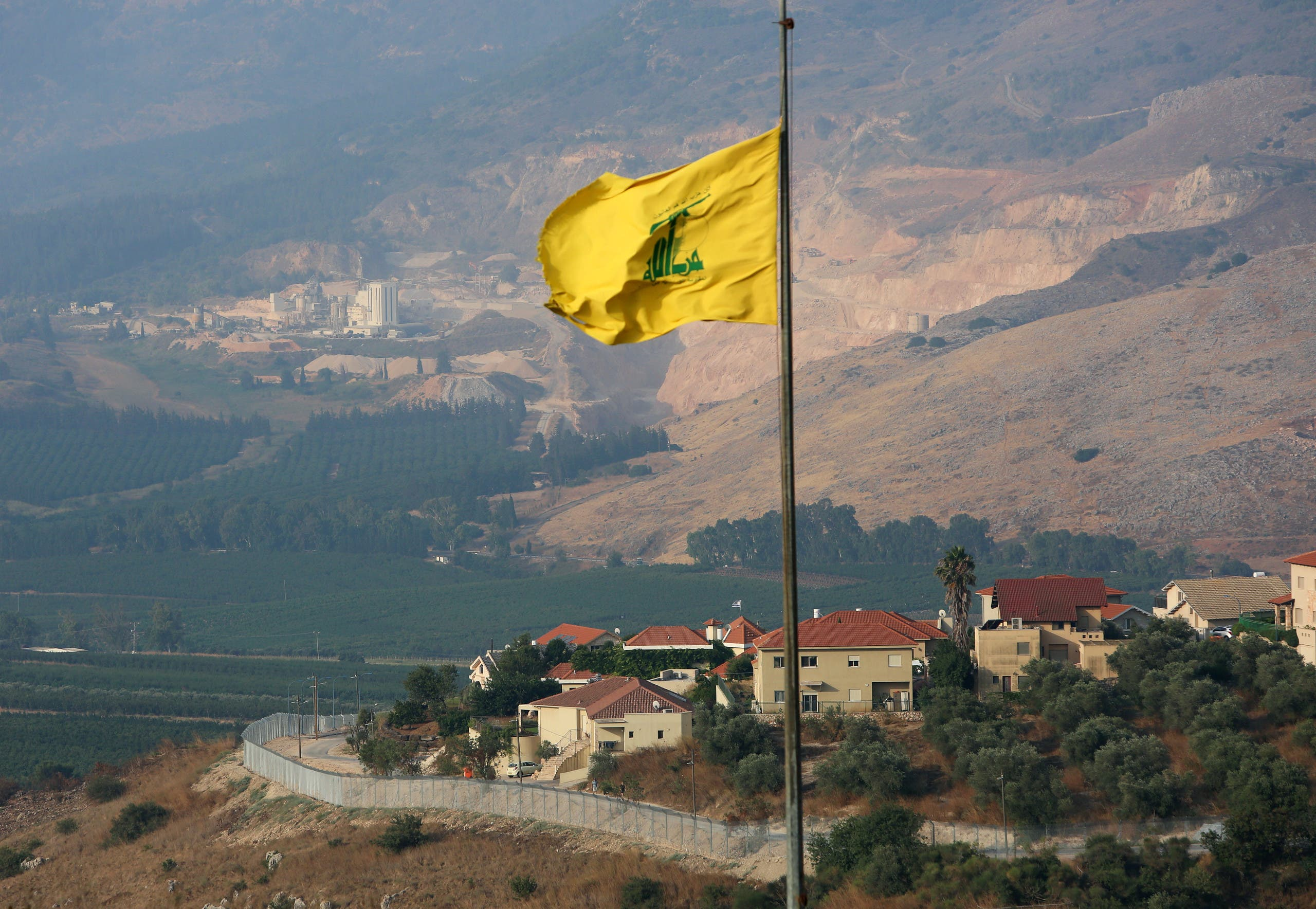 A Hezbollah flag flutters in the southern Lebanese village of Khiam, near the border with Israel, Lebanon July 28, 2020. (Reuters)