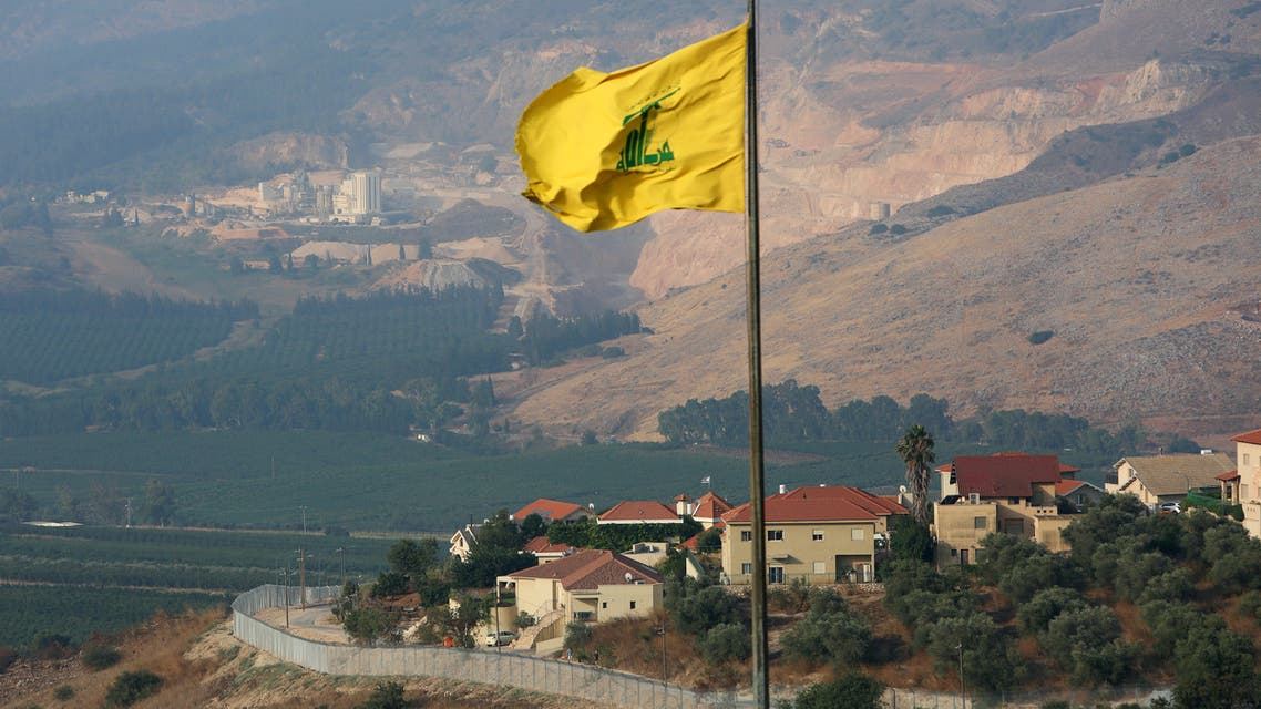 A Hezbollah flag flutters in the southern Lebanese village of Khiam, near the border with Israel, Lebanon July 28, 2020. REUTERS/Aziz Taher