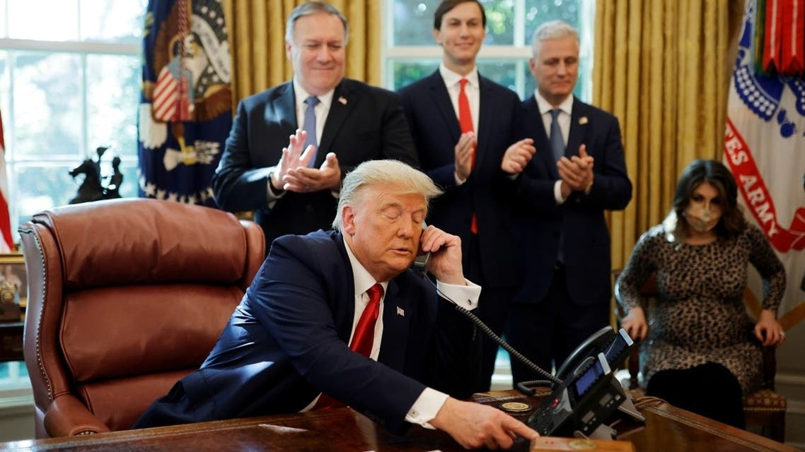 Secretary of State Mike Pompeo and White House senior advisor Jared Kushner applaud as US President Donald Trump talks to the leaders of Israel and Sudan, Oct. 23, 2020. (Reuters)
