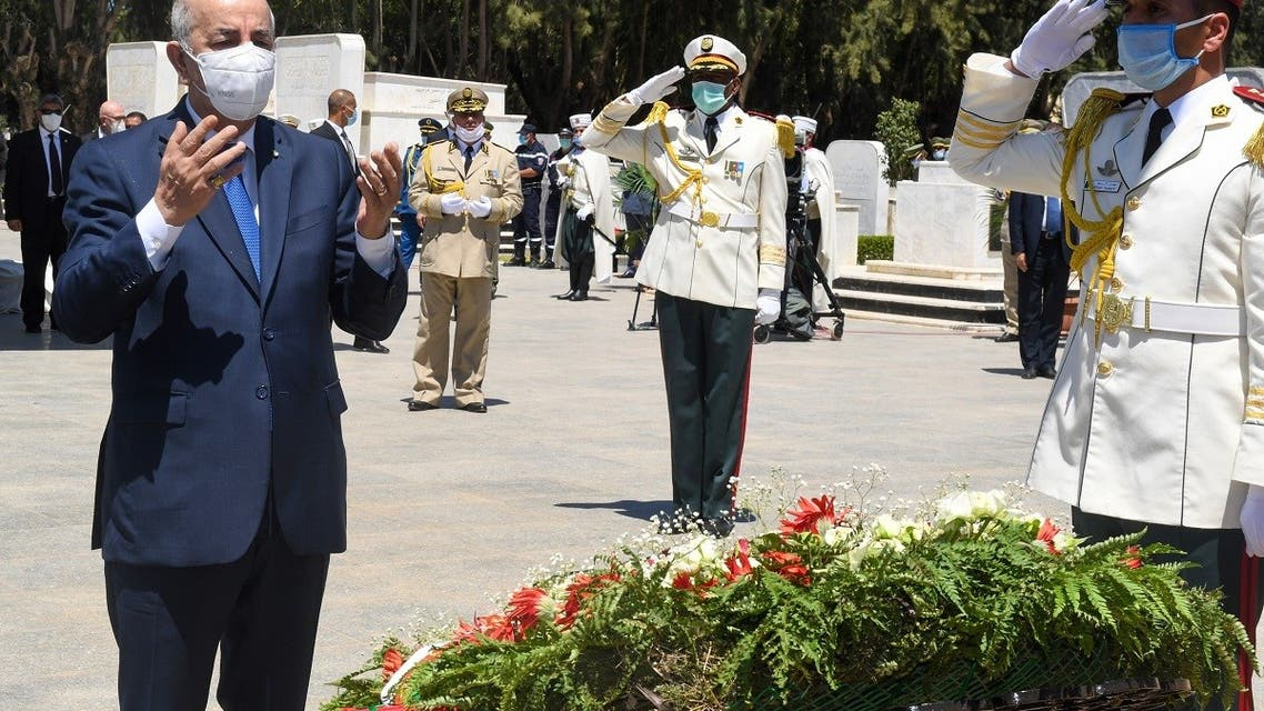Algeria's President Abdelmajid Tebboune praying during a ceremony to lay to rest the remains of 24 resistance fighters. (AFP)