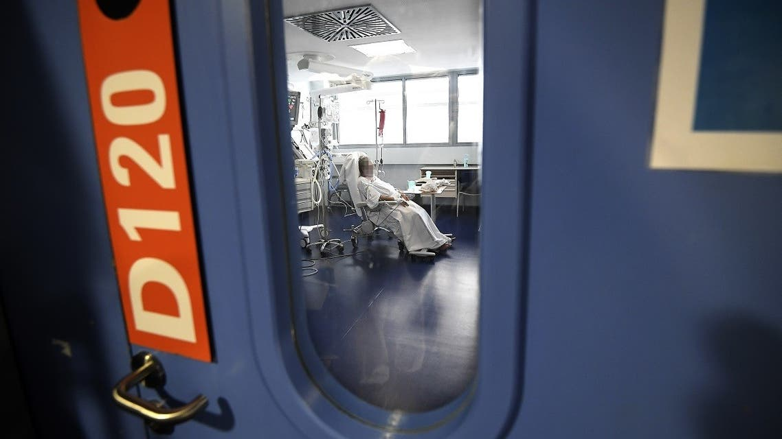 A patient is hospitalised in an intensive care unit for patients infected with Covid-19 (novel coronavirus) at the University Hospital of Strasbourg (HUS) in Strasbourg, eastern France. (AFP)