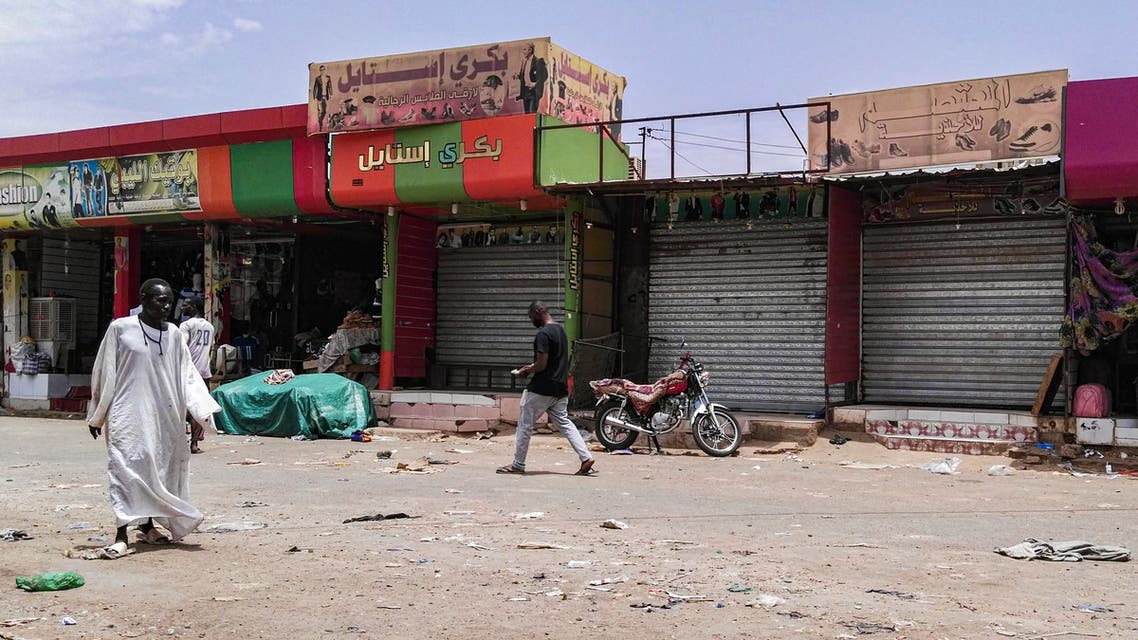 Sudanese men walk past closed shops in the capital Khartoum on June 11, 2019, on the third day of a civil disobedience campaign launched by protest leaders after a crackdown on a weeks-long sit-in left dozens dead on June 3. The protest strike kept most businesses shut and residents hunkered indoors in the Sudanese capital as a top US diplomat prepared a visit to press the ruling generals to halt a bloody crackdown.