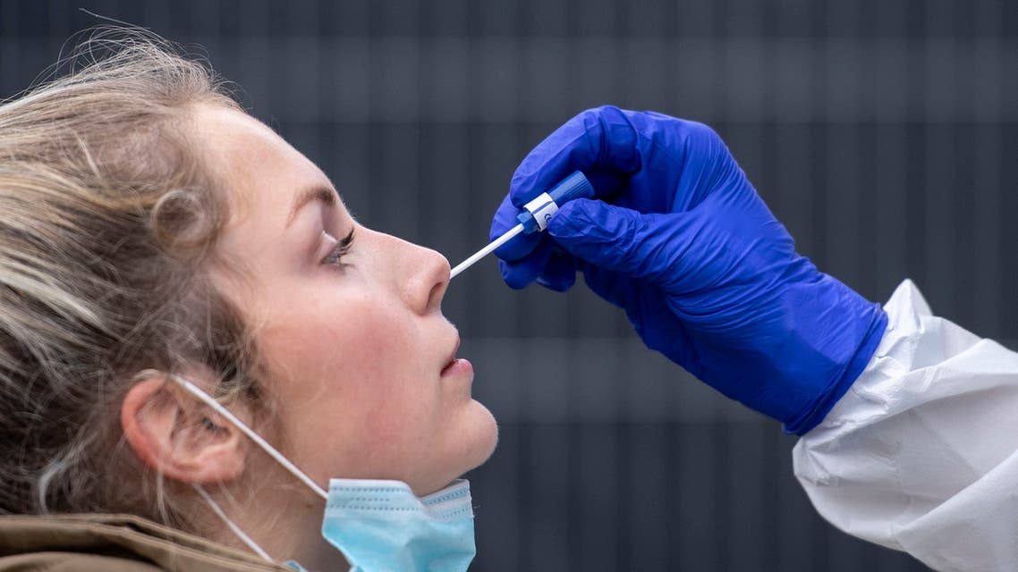 A woman gets a nasal swab at the corona test center at Central Station in Cologne, Germany. (AP)
