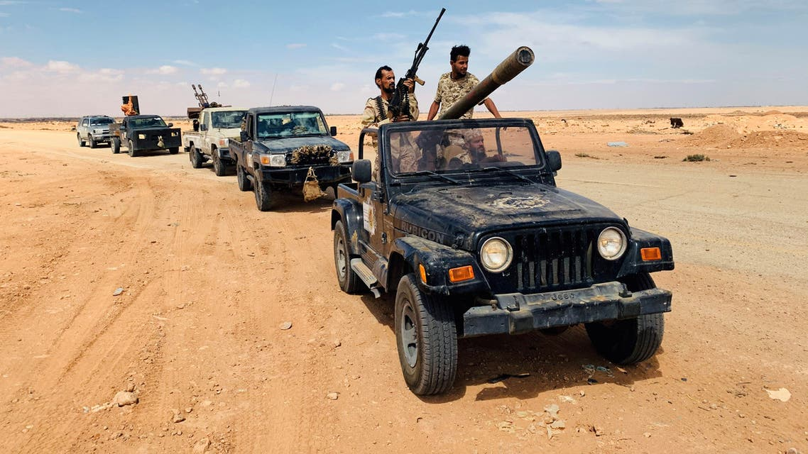Troops loyal to Libya's internationally recognized government patrol the area in Zamzam, near Abu Qareen, Libya September 15, 2020. Picture taken September 15, 2020. REUTERS/Ayman Al-Sahili