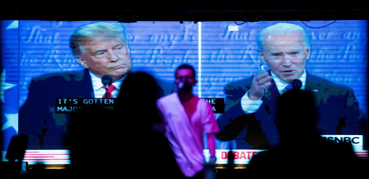 People watch the second 2020 presidential campaign debate between Biden and Trump at The Abbey Bar during the outbreak of the coronavirus disease, in West Hollywood, California. (Reuters)