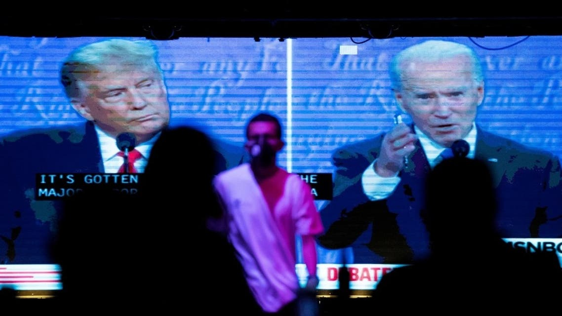People watch the second 2020 presidential campaign debate between Democratic presidential nominee Joe Biden and U.S. President Donald Trump at The Abbey Bar during the outbreak of the coronavirus disease (COVID-19), in West Hollywood, California. (Reuters)