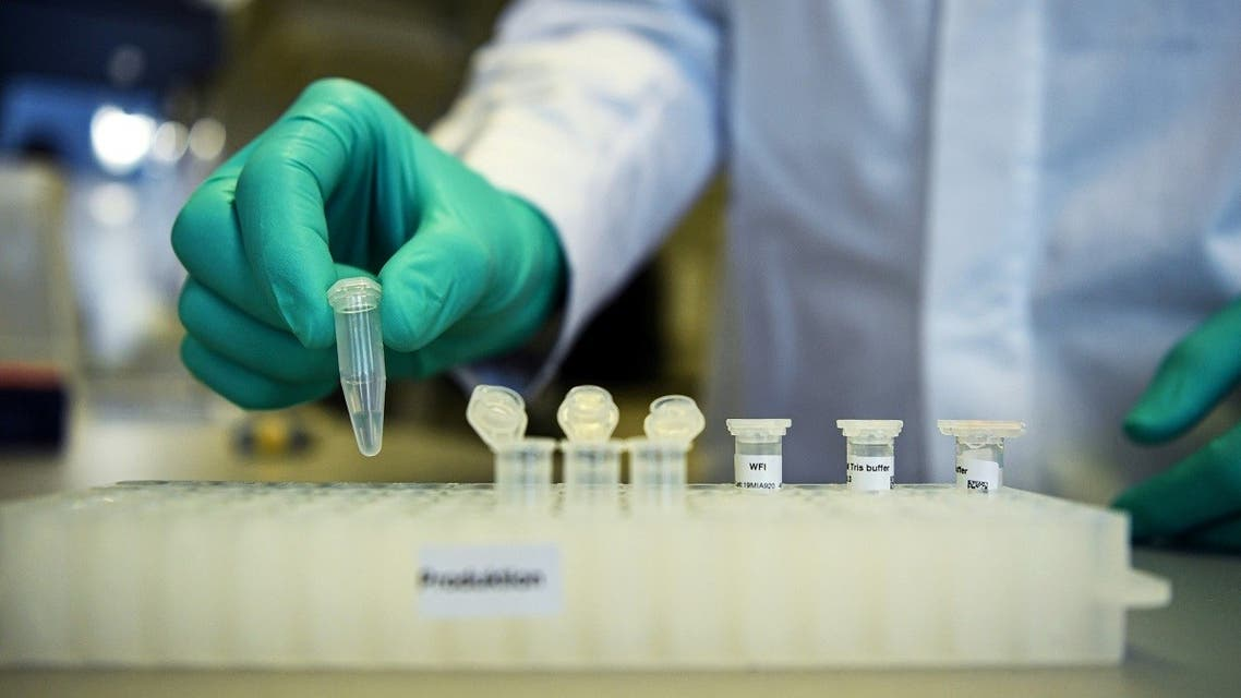 A CureVac employee demonstrates research workflow on a vaccine for the coronavirus (COVID-19) disease at a laboratory in Tuebingen. (Reuters)