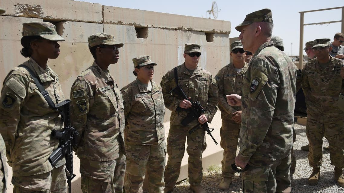 The US commander in Afghanistan John Nicholson (R) talks with soldiers ahead of a handover ceremony at Leatherneck Camp in Lashkar Gah in the Afghan province of Helmand on April 29, 2017. US Marines returned to Afghanistan's volatile Helmand April 29, where American troops faced heated fighting until NATO's combat mission ended in 2014, as embattled Afghan security forces struggle to beat back the resurgent Taliban. The deployment of some 300 Marines to the poppy-growing southern province came one day after the militants announced the launch of their spring offensive, and as the Trump administration seeks to craft a new strategy in Afghanistan.