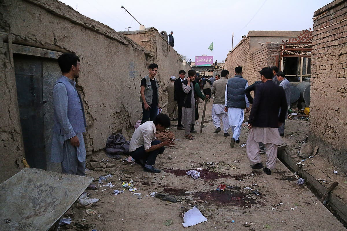 Residents gather at a site following a suicide bomber blew himself up in an education centre, in Kabul on October 24, 2020. (AFP)