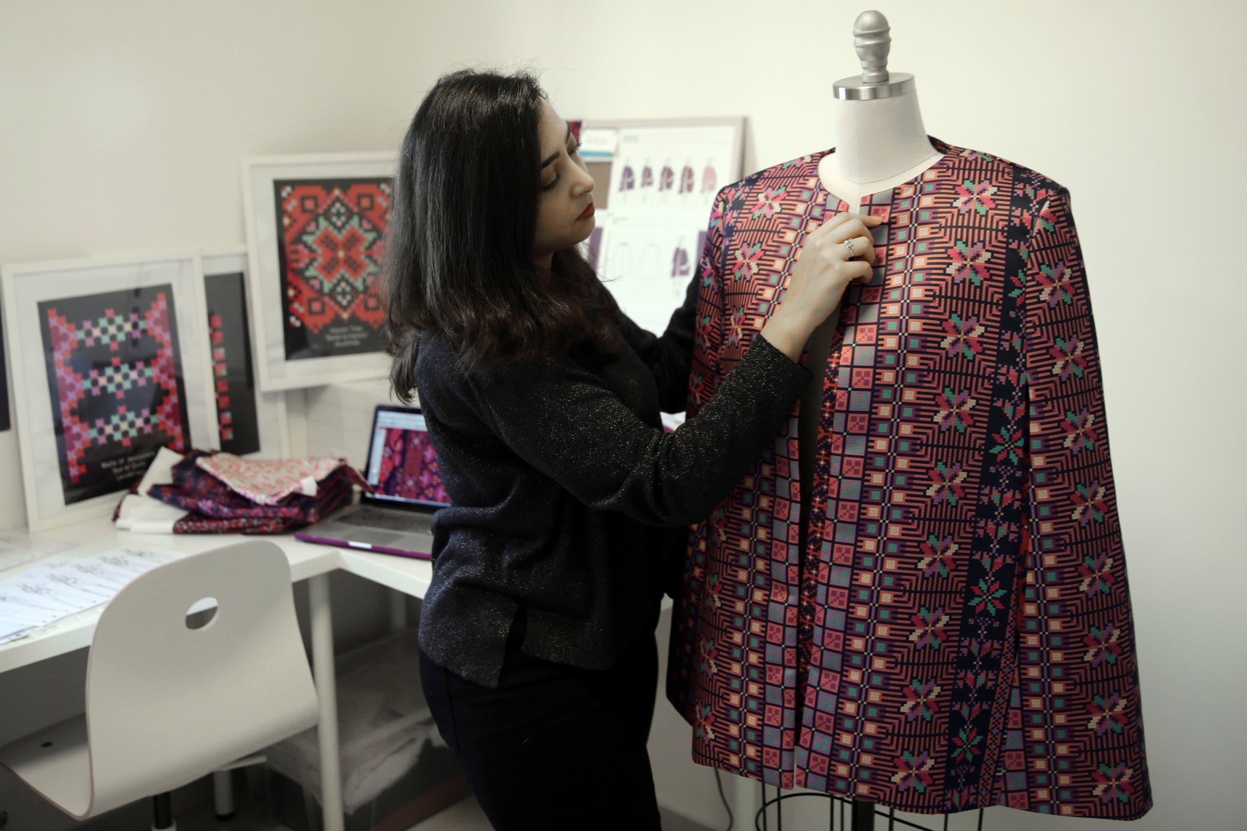 Designer Natalie Tahhan works on a modern version of the traditional Palestinian thobe in her studio in East Jerusalem on Jan. 29, 2019. (AP)