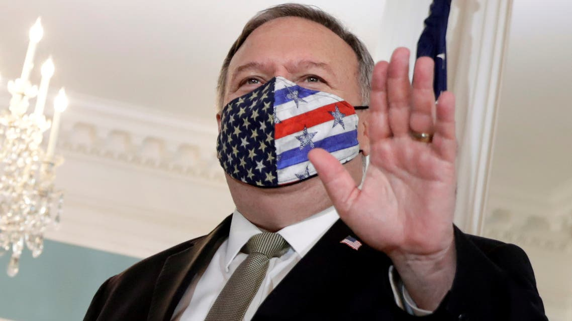 FILE PHOTO: U.S. Secretary of State Mike Pompeo waves before his meeting with Romania's Foreign Minister Bogdan Aurescu at the State Department in Washington, U.S., October 19, 2020. REUTERS/Yuri Gripas?/File Photo