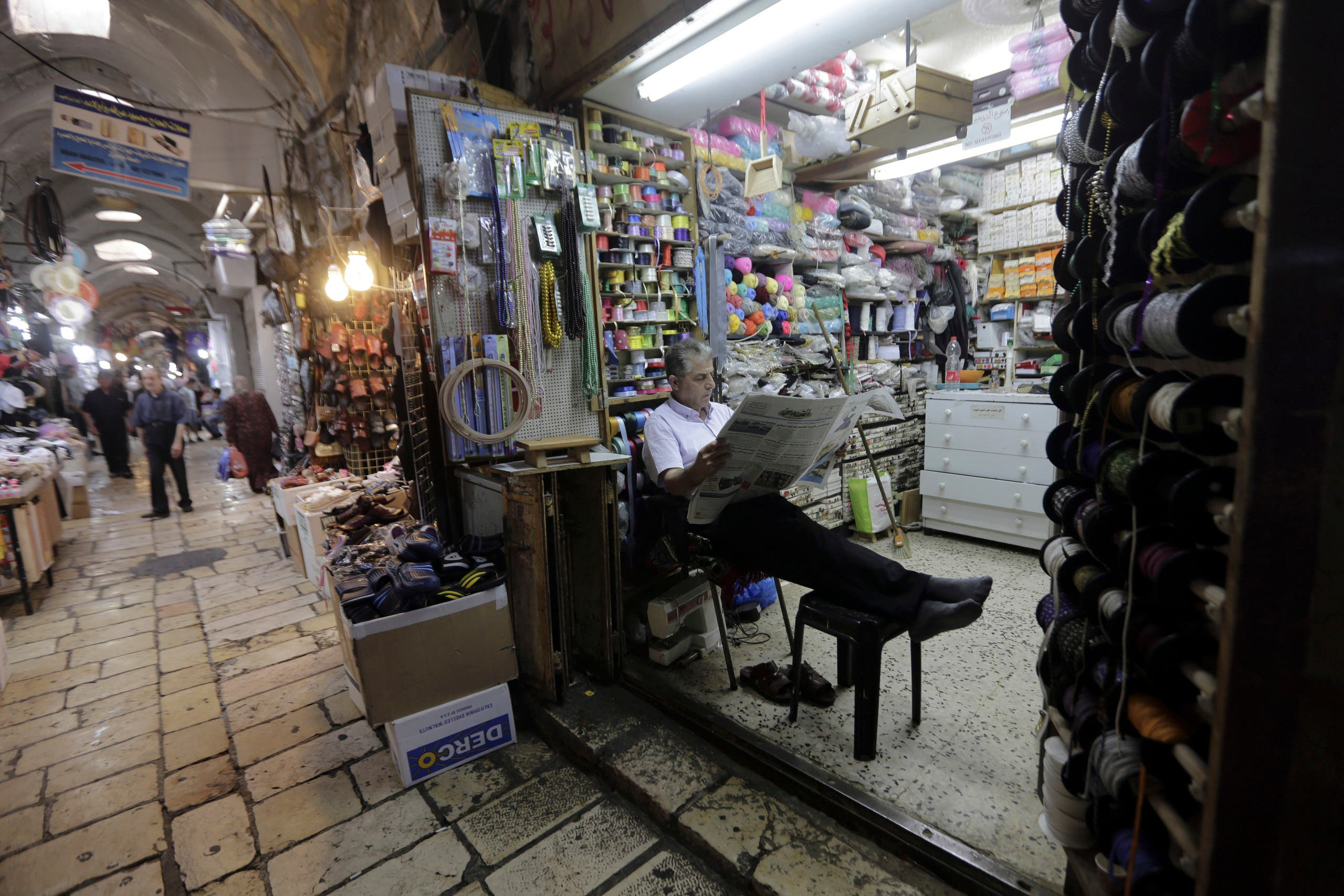 A shopkeeper waits for customers in the Muslim Quarter of the Old City in East Jerusalem on July 11, 2018. (AP)