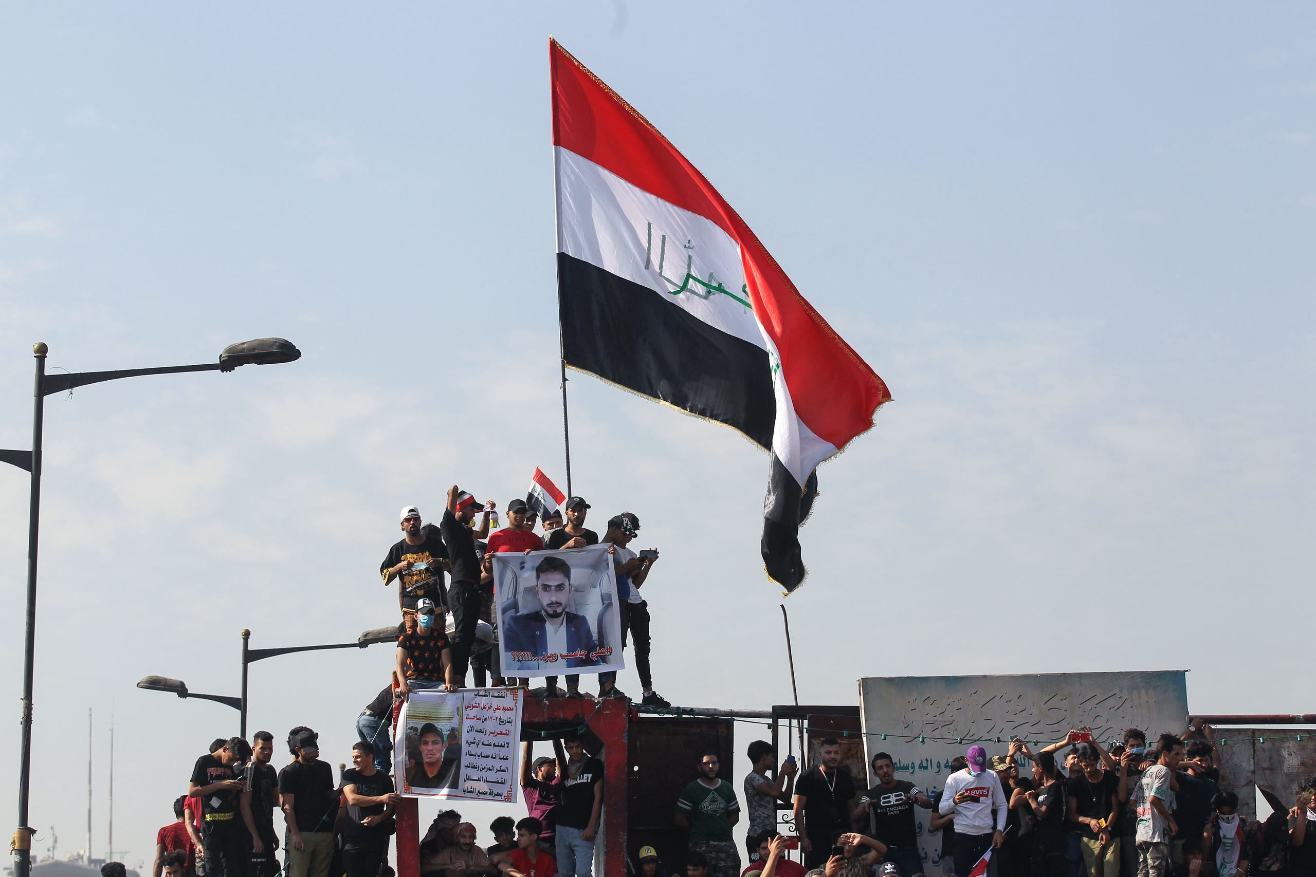 Iraqi protesters on Al-Jumhuriya Bridge in the capital Baghdad on October 25, 2020. (AFP)