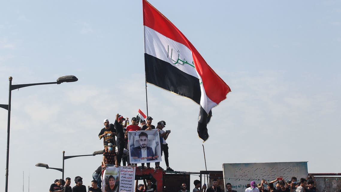 Iraqi protesters on Al-Jumhuriya Bridge in the capital Baghdad on October 25, 2020. (AFP)