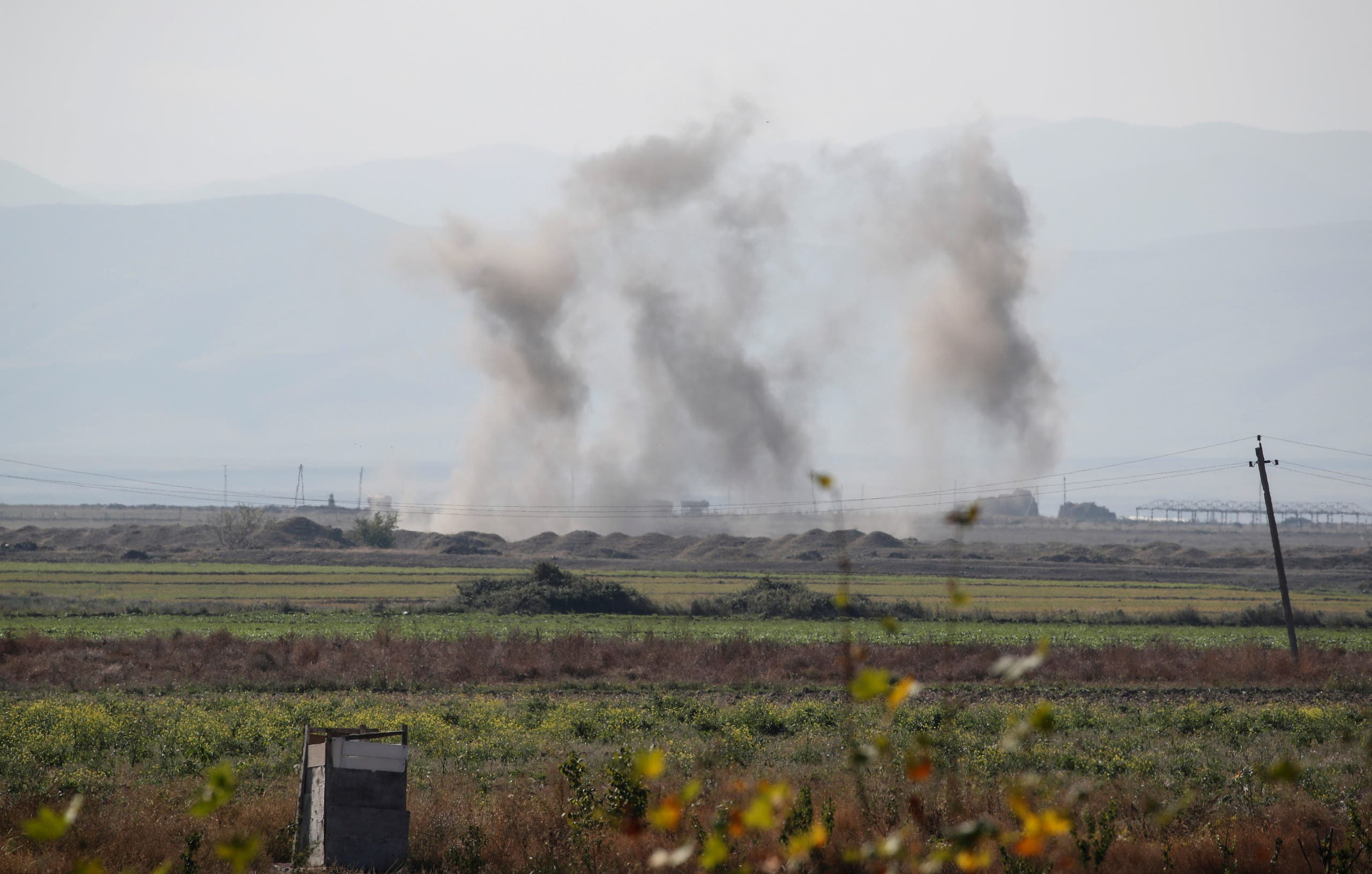 Smoke rises as targets are hit by shelling during the fighting over the region of Nagorno-Karabakh near the city of Terter, Azerbaijan on October 23, 2020. (Reuters)