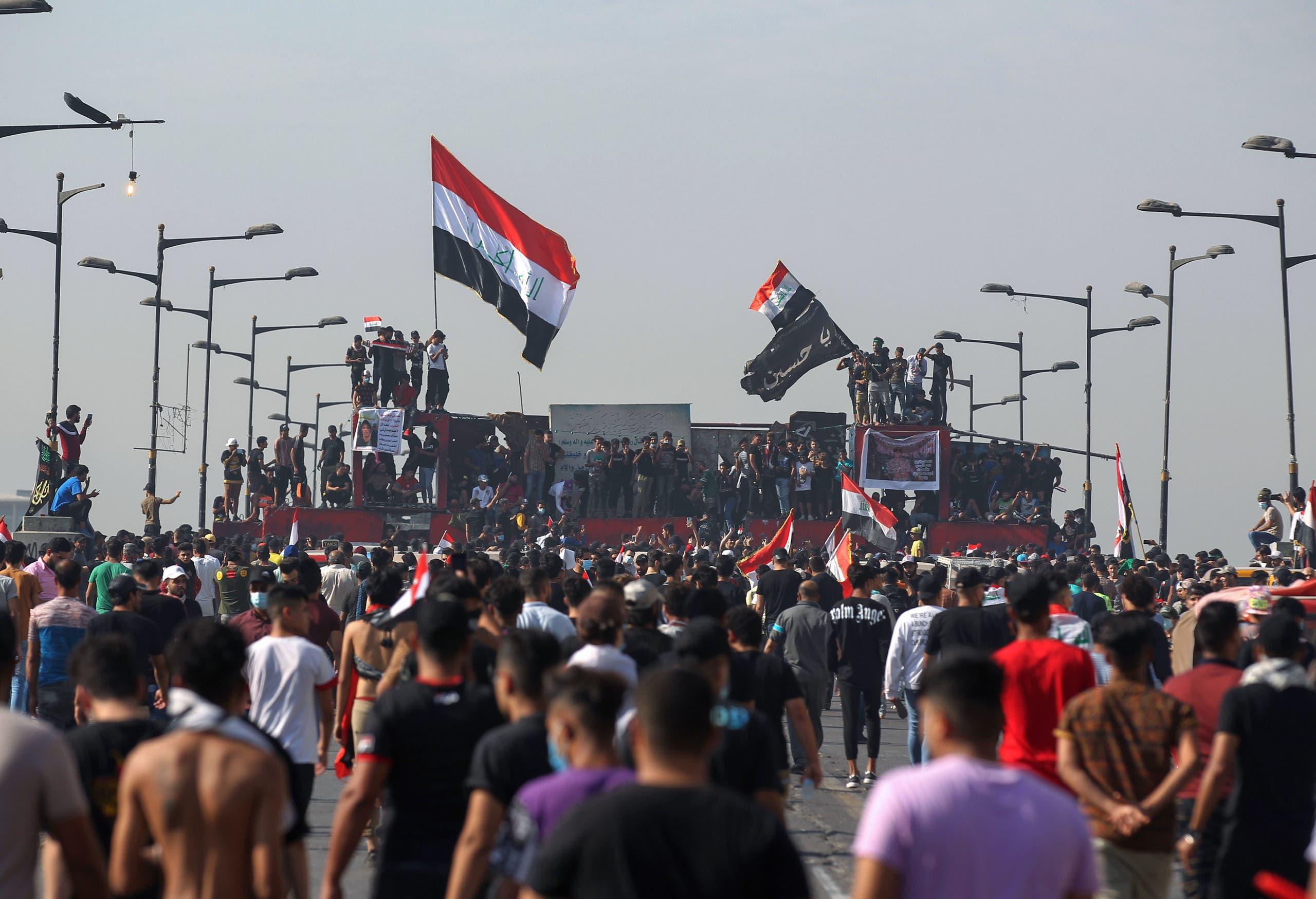 Iraqi protesters gather on Al-Jumhuriya Bridge in the capital Baghdad on October 25, 2020. (AFP)