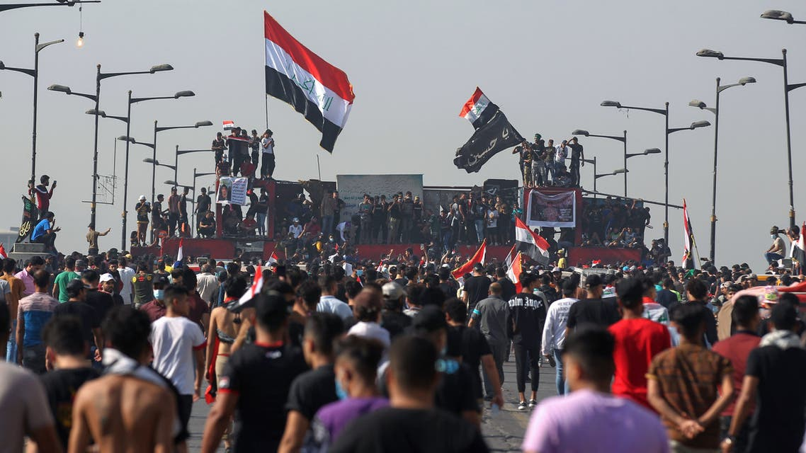 Iraqi protesters gather on Al-Jumhuriya Bridge in the capital Baghdad on October 25, 2020. (AFP)