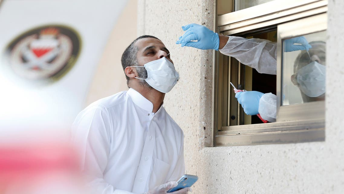 A Saudi national travelling into Bahrain gets a nose swab at an immigration checkpoint on the King Fahd Causeway that reopened after coronavirus disease (COVID-19) restrictions were eased, at the Bahrain-Saudi border, Bahrain, September 15, 2020. (Reuters)