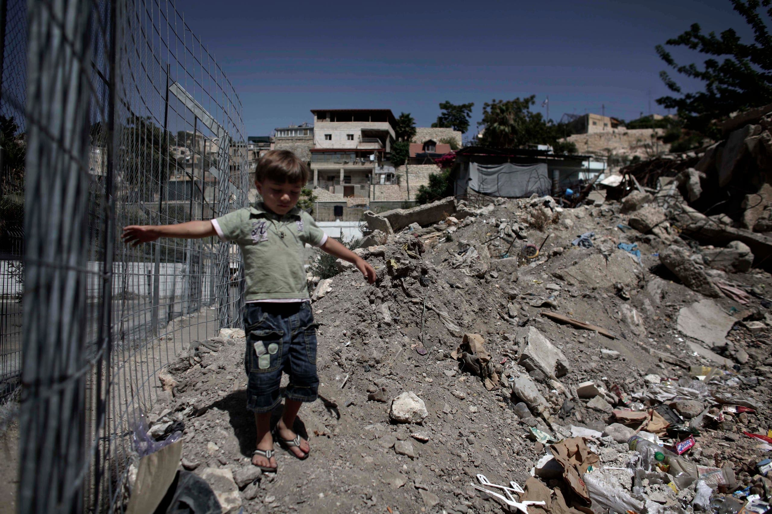 A Palestinian child walks near rubble in the East Jerusalem neighborhood of Silwan on June 21, 2010. (AP)