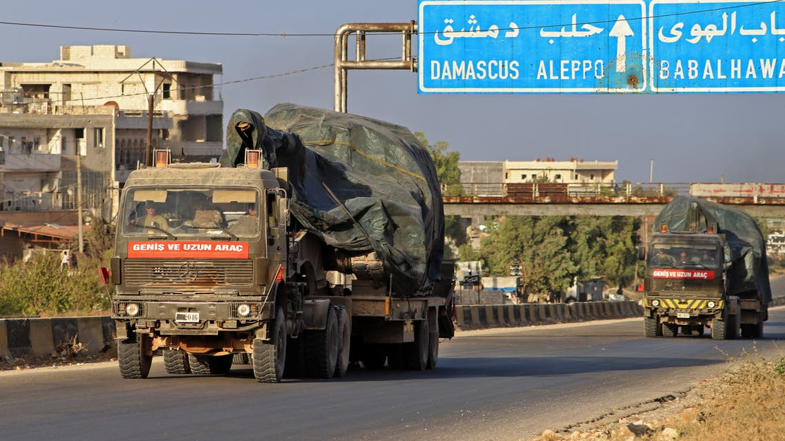 Turkish military vehicles, part of a convoy, drive through the town of Ariha in the rebel-held northwestern Idlib province on October 20, 2020, after vacating the Morek post in Hama's countryside. Turkey started withdrawing from one of its largest outposts in northwest Syria encircled for the past year by Syrian regime forces, a war monitor and a pro-Ankara rebel commander said. The outpost in Morek is Turkey's largest in the northwest province of Hama, which is now mostly under Syrian government control.