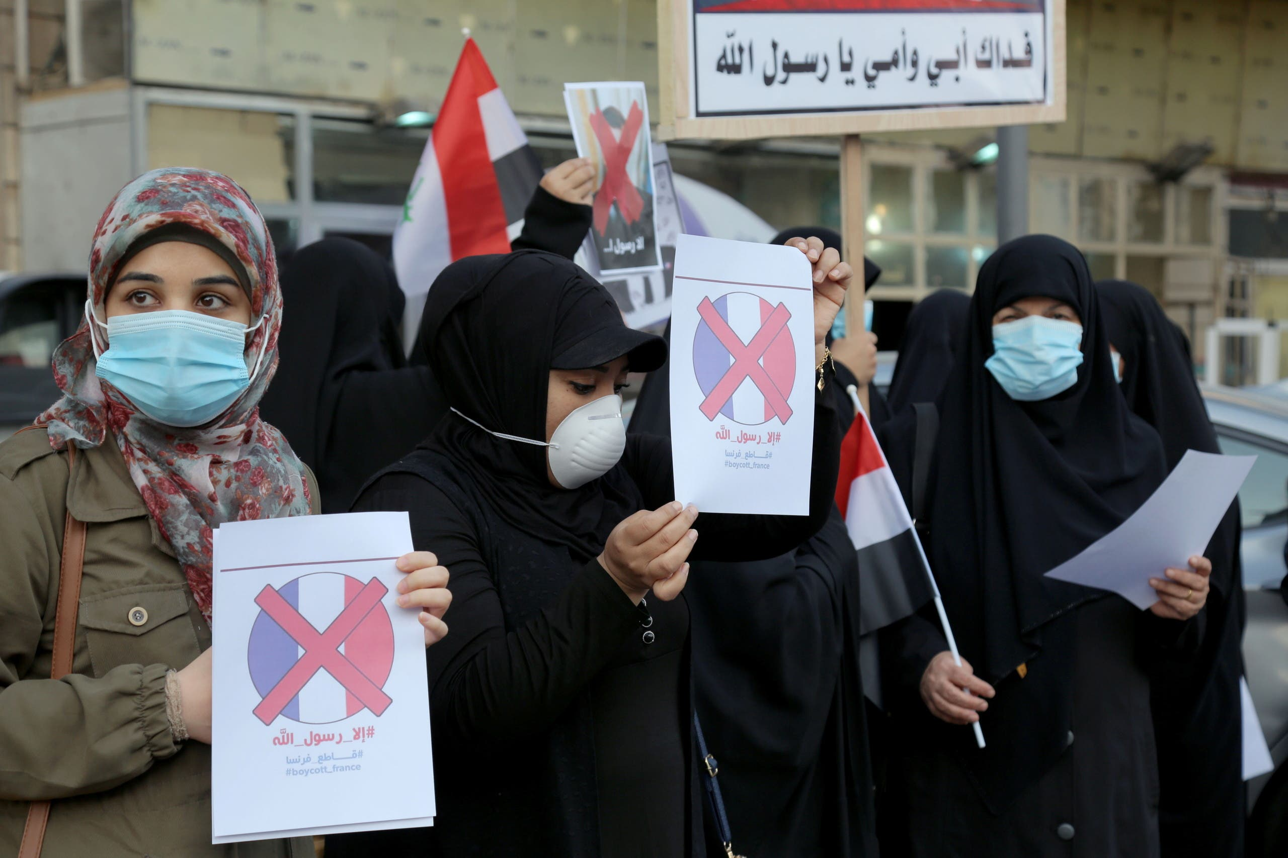 Iraqi people gather during a protest against the publications of a cartoon of Prophet Mohammad in France and French President Emmanuel Macron's comments, outside the French embassy in Baghdad, Iraq, October 26, 2020. (Reuters)