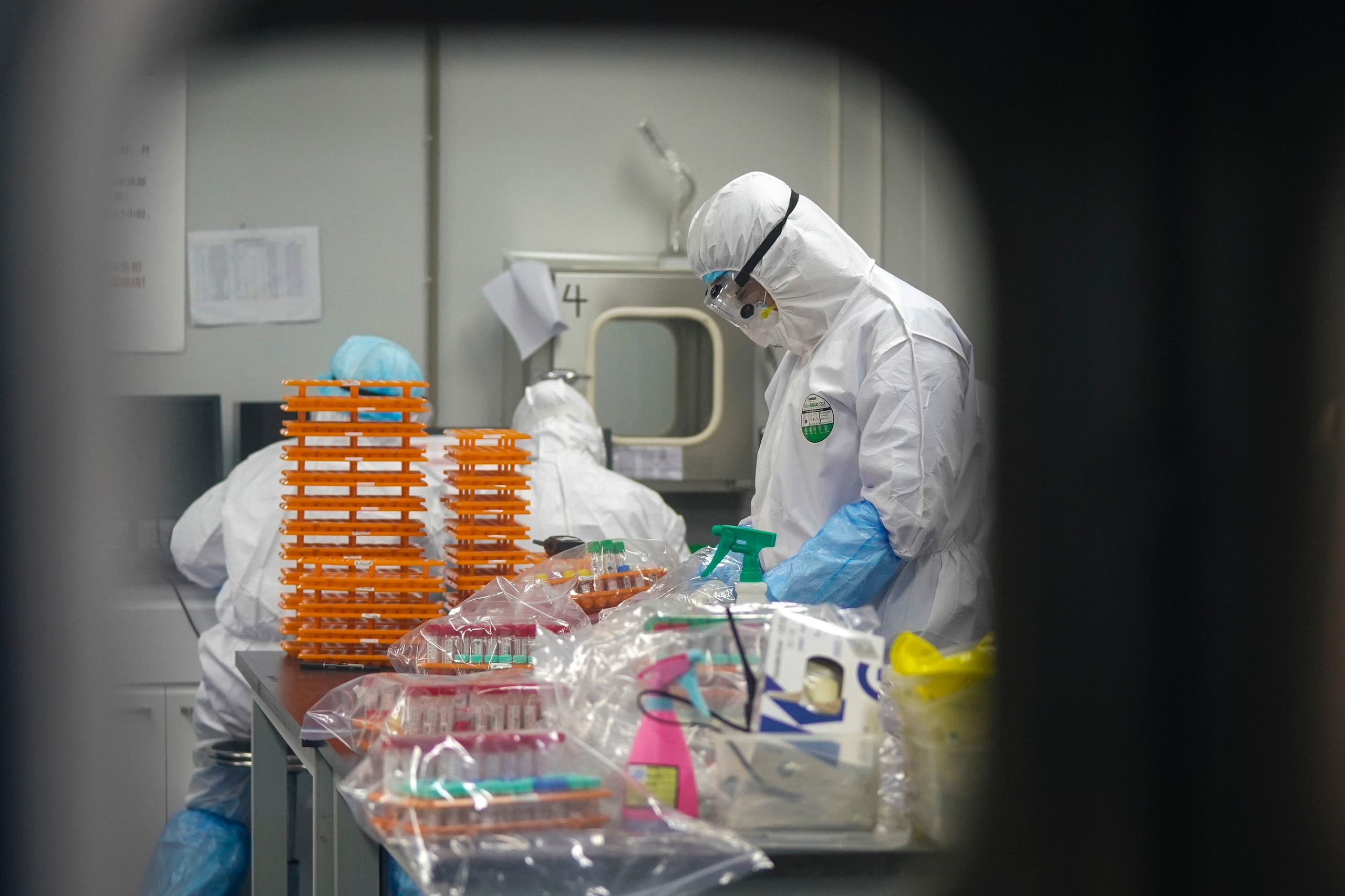 Medical workers in protective suits at a coronavirus detection lab in Wuhan in central China's Hubei Province. (File photo: AP)