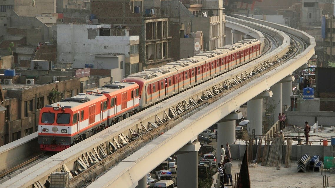 Orange Line Metro Train (OLMT) on its first test-run, travels along a track in a neighbourhood in Lahore, Pakistan. (Reuters)