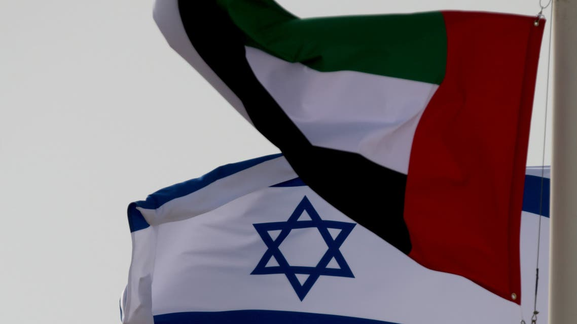 Emirati and Israeli flags fly upon the arrival of Israeli and U.S. delegates at Abu Dhabi International Airport, in Abu Dhabi, United Arab Emirates August 31, 2020. (Reuters)