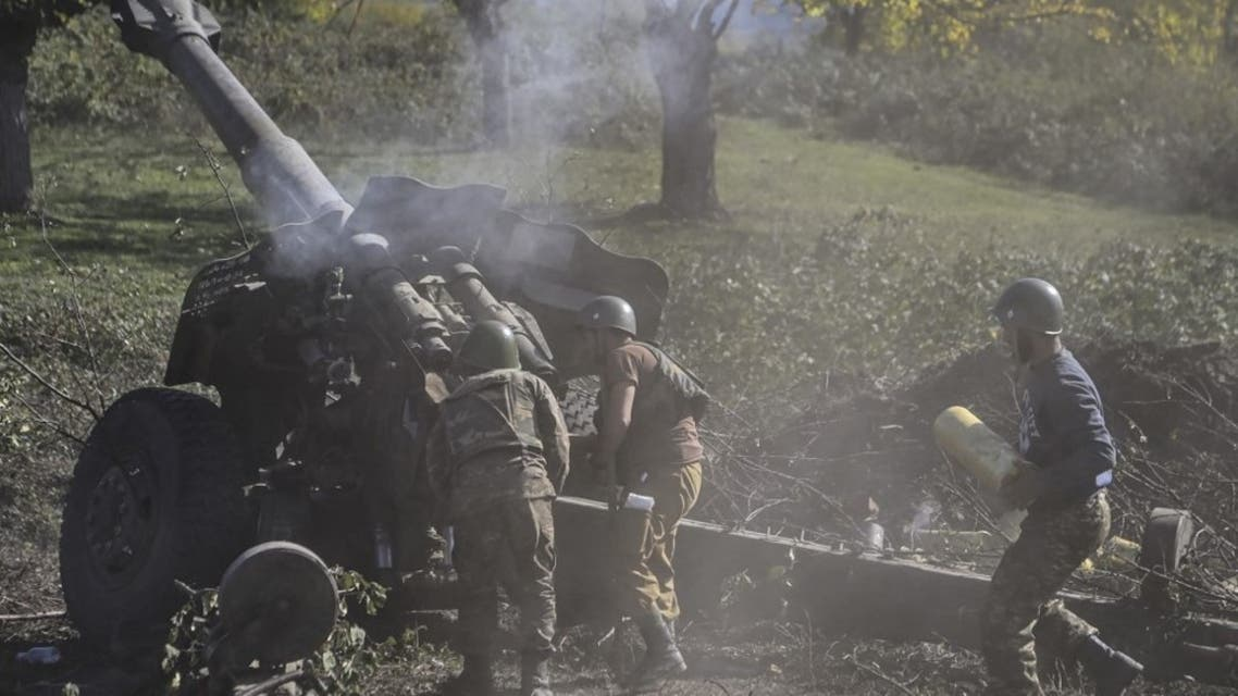 Armenian soldiers fire artillery on the front line on October 25, 2020, during the ongoing fighting between Armenian and Azerbaijani forces over the breakaway region of Nagorno-Karabakh. (AFP)