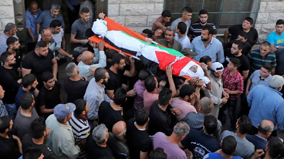 Palestinian mourners carry the body of 18-year-old Amer Abdel-Rahim Sanouber during his funeral in the village of Yatma in the occupied West Bank on Oct. 25, 2020. (AFP)