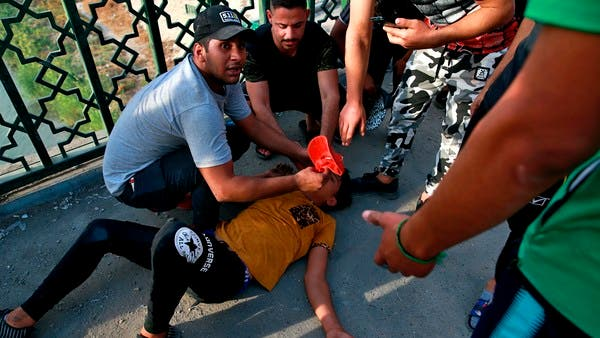 Iraq protesters, police clash again one year after uprising began
