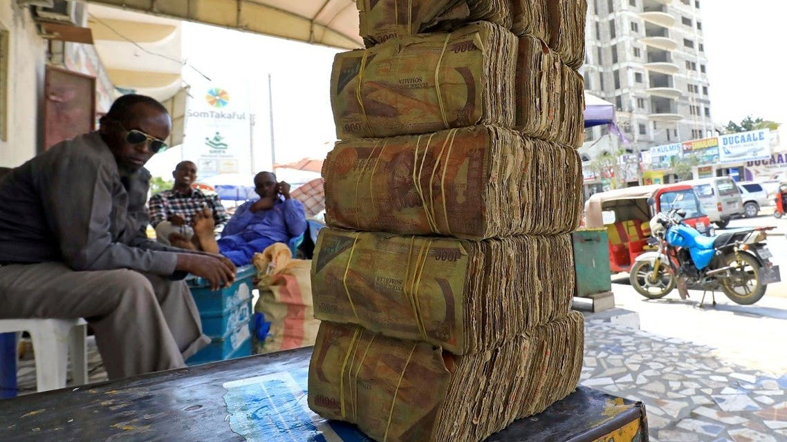 A file photo shows bundles of Somali shilling, the Somalian currency, are seen arranged at an open air currency exchange bureau within the Hamarweyne open air market in Mogadishu, Somalia February 5, 2020. (Reuters/Feisal Omar)