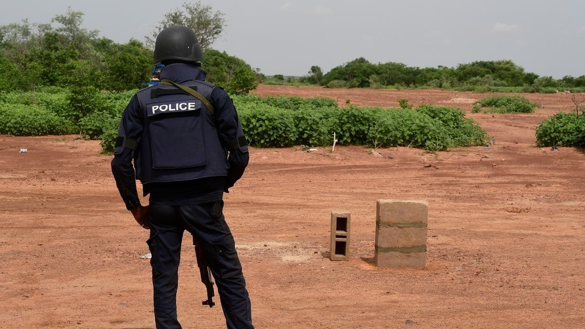 A Nigerien police officer stands guard in the Kouré Reserve, about 60 km from Niamey on August 21, 2020, at the scene where six French aid workers, their local guide and the driver were killed by unidentified gunmen riding motorcycles on August 9, 2020. (AFP)