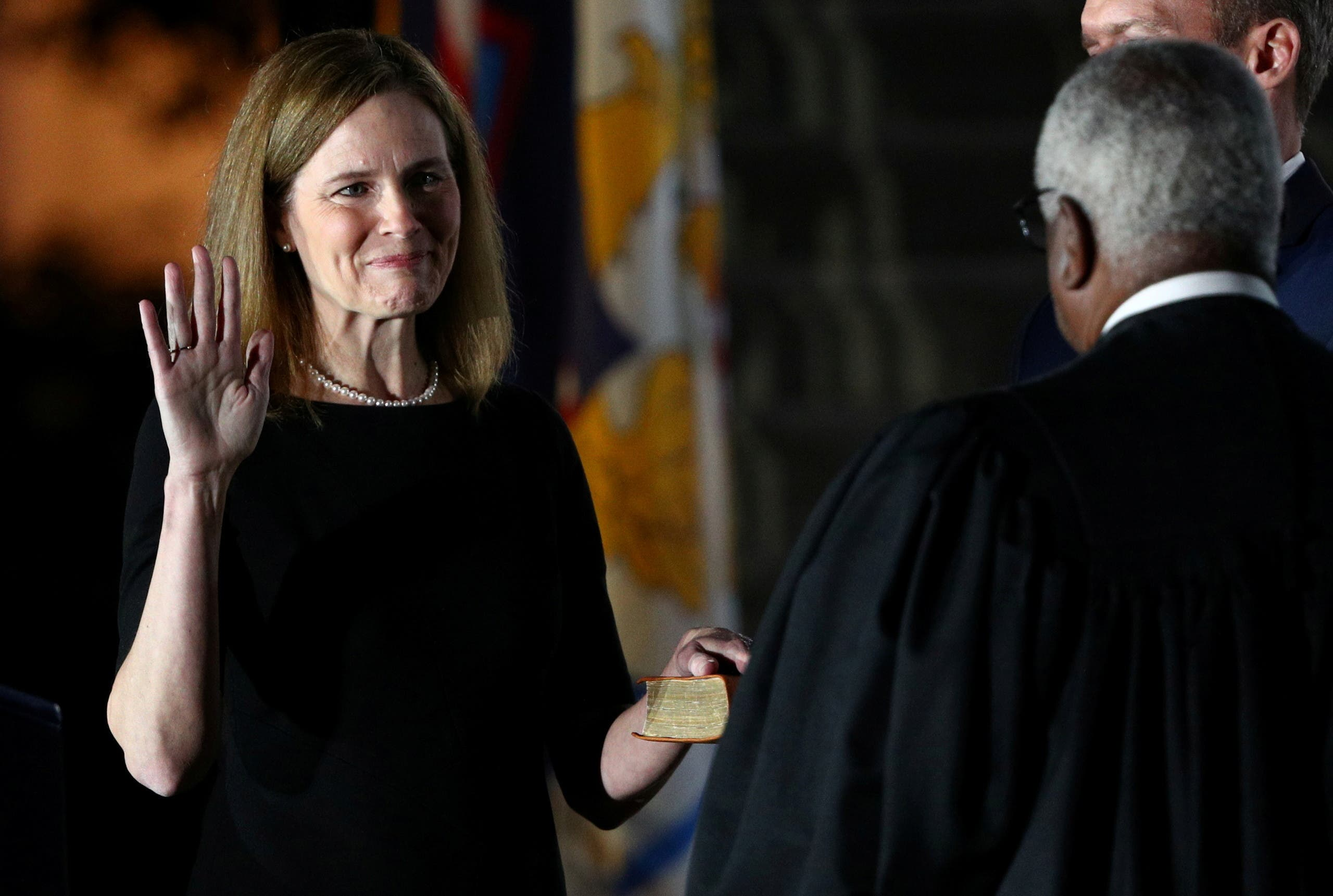 Trump pick Judge Amy Coney is sworn in as an associate justice of the US Supreme Court at the White House in Washington. (Reuters)