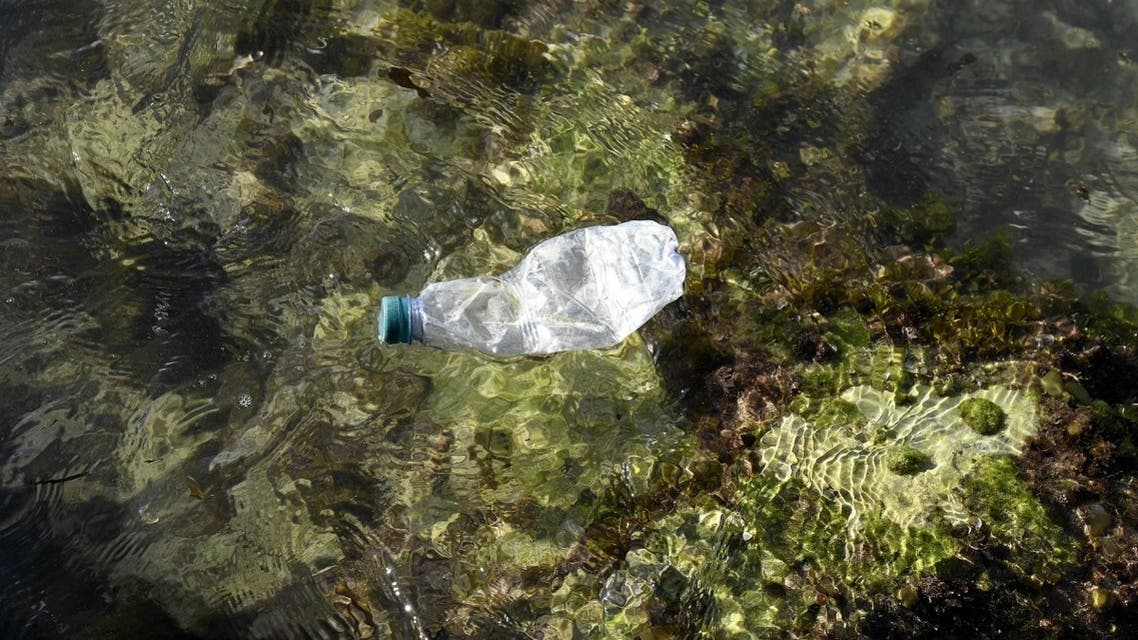 This picture taken in Marseille, southern France, shows a plastic bottle floating in the Mediterranean sea on October 27, 2020. (AFP/Nicolas Tucat)