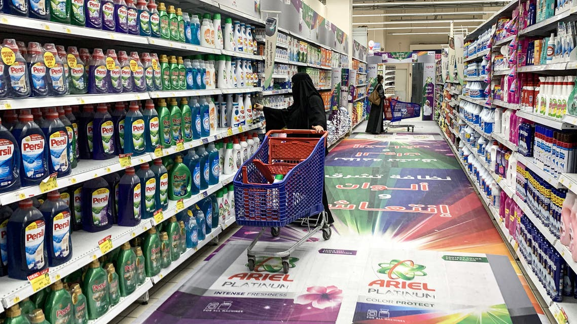 A woman shops for laundry detergent at a supermarket in Saudi Arabia's capital Riyadh on October 18, 2020.  (AFP)