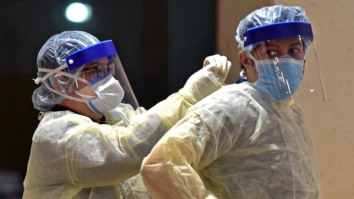 Health workers prepare to perform nose swab tests during a drive through coronavirus test campaign held in Diriyah hospital in the Saudi capital Riyadh. (Reuters)