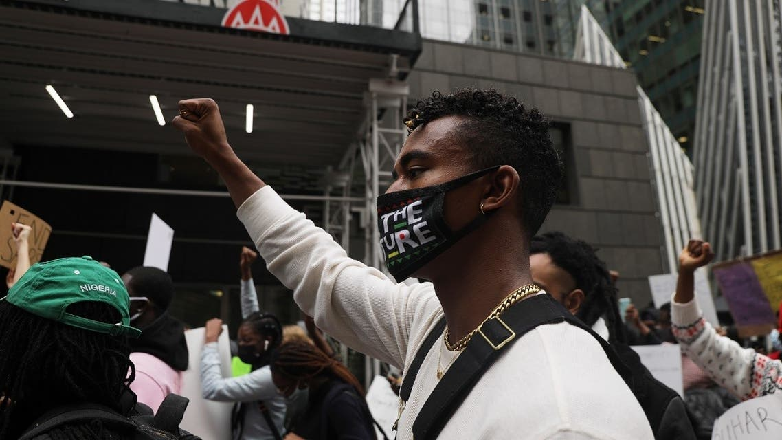 People protest against recent violence at demonstrations in Nigeria on October 21, 2020, in New York City. (AP)