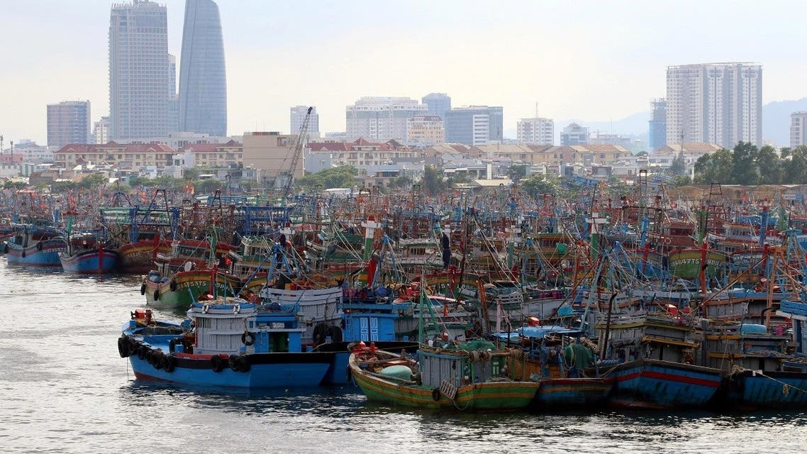 Fishing boats are seen at a port after returning to avoid Molave typhoon in Da Nang city, Vietnam October 26, 2020. (Reuters)
