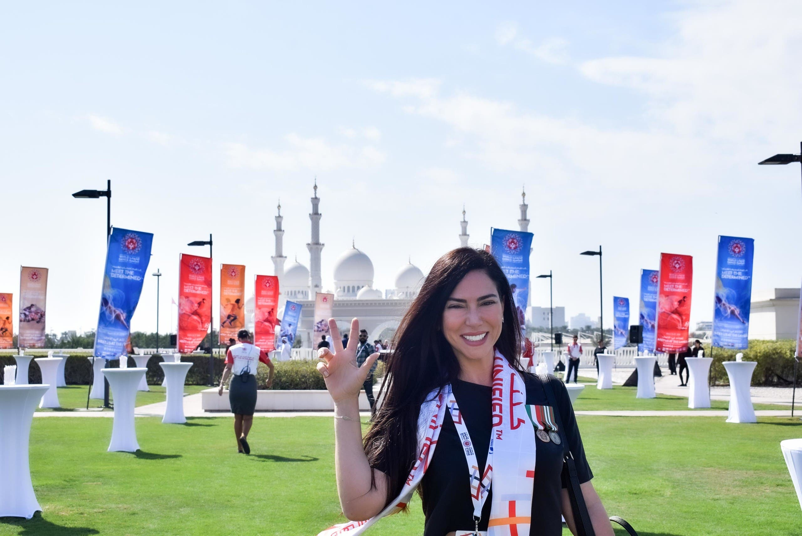 Italian producer Benedetta Paravia during the 2019 Special Olympics, in front of the Sheikh Zayed Grand Mosque in Abu Dhabi. (Supplied)