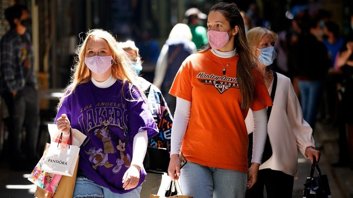 Shoppers walk down a city laneway after coronavirus restrictions were eased for the state of Victoria, in Melbourne, Australia, on October 28, 2020. (Reuters)