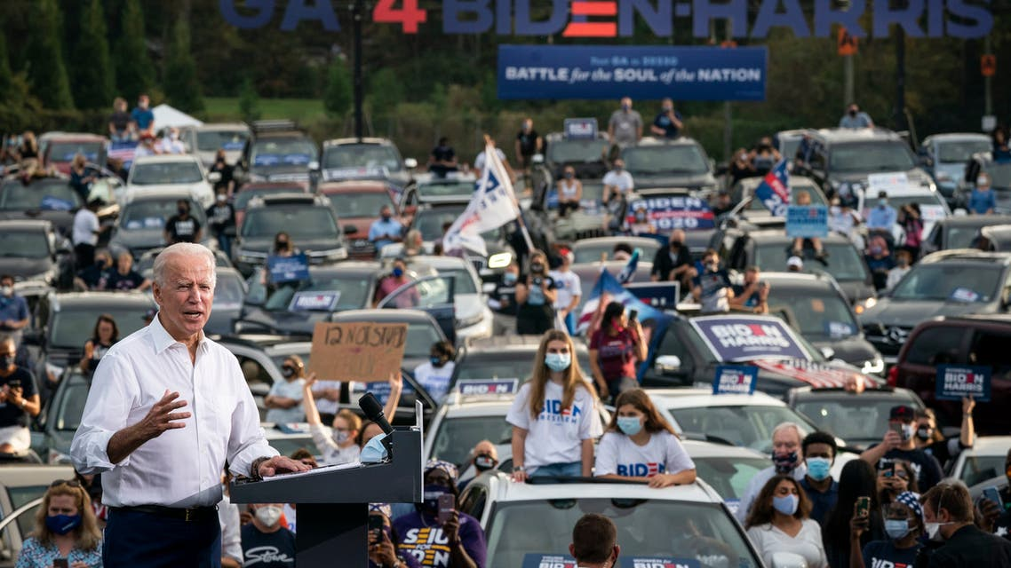 ATLANTA, GA - OCTOBER 27: Democratic presidential nominee Joe Biden speaks during a drive-in campaign rally in the parking lot of Cellairis Ampitheatre on October 27, 2020 in Atlanta, Georgia. Biden is campaigning in Georgia on Tuesday, with scheduled stops in Atlanta and Warm Springs. Drew Angerer/Getty Images/AFP